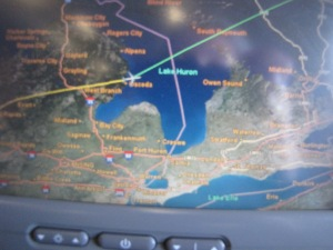 Picture of the map on the plane as we moved out of Michigan over Lake Huron and into Canada